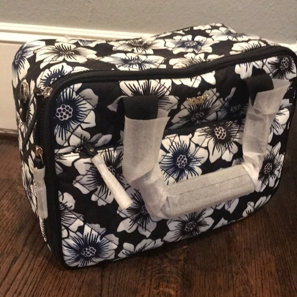 kate spade Handbags - Kate Spade Ridge Street travel bag (floral)
